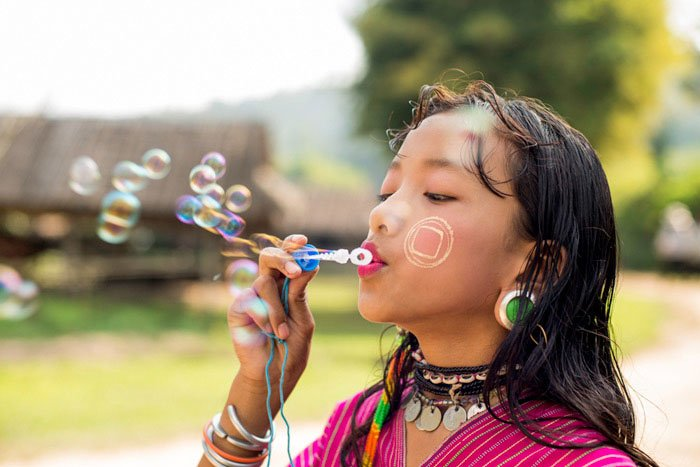 Kayaw girl blowing bubbles