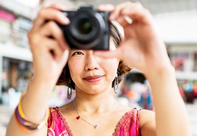 Asian woman taking a photo