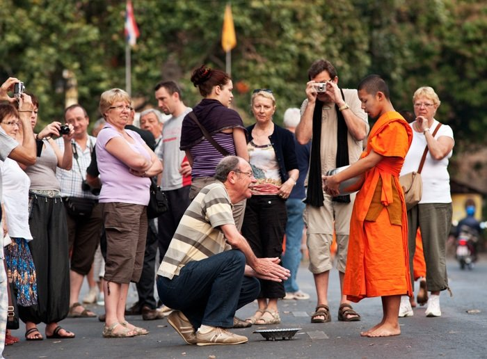 tourists photographing monks in Chiang Mai