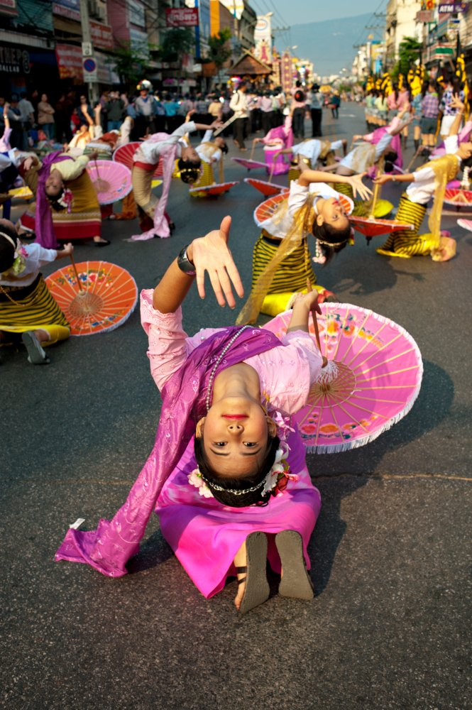 A female dancer performs during the annual flower festival parade in Chiang Mai, Thailand.