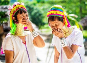 Two long neck Kayan women having a good laugh during a Chiang Mai Photo Workshop